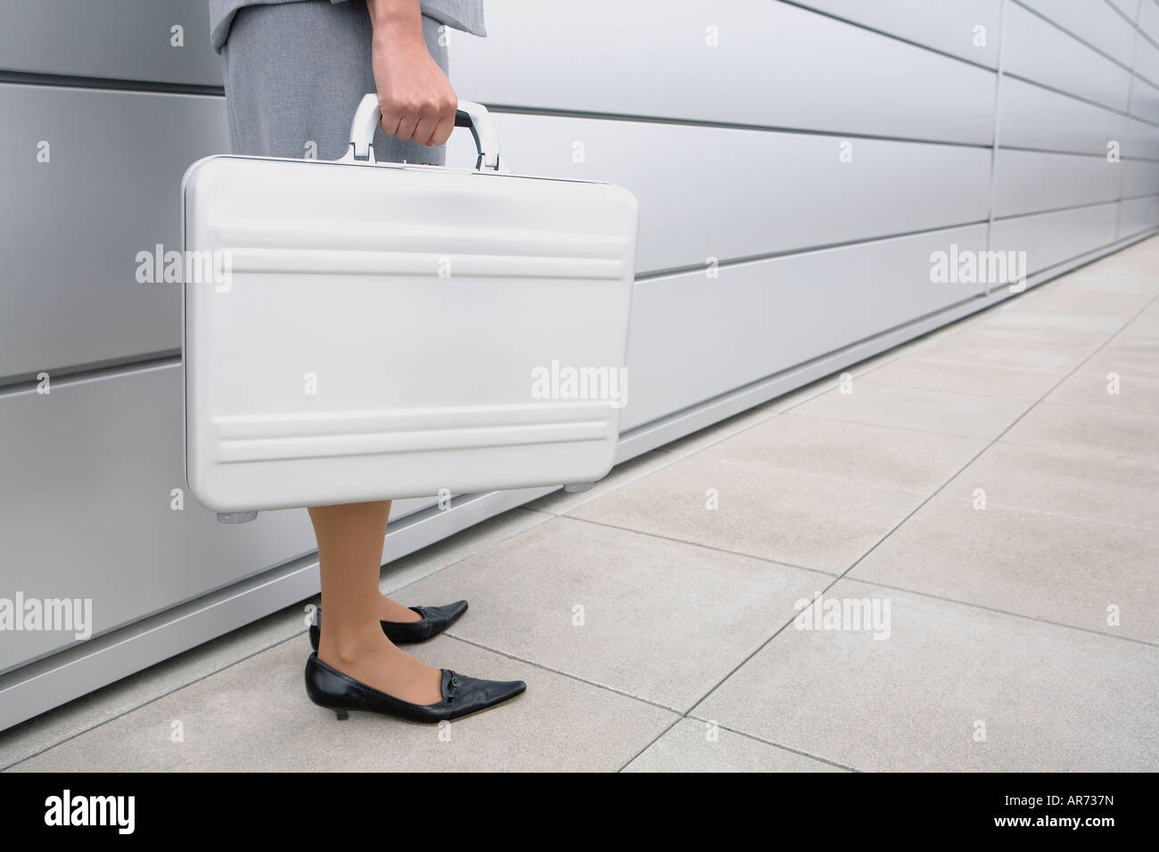 African businesswoman holding briefcase - Stock Image