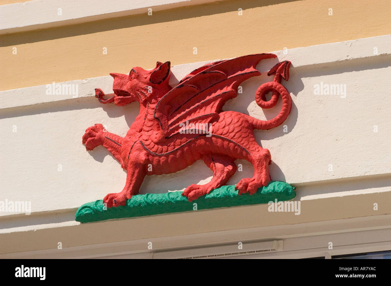 Relief Carving of a Red Dragon symbol of Wales at Cardiff Bay Historic Welsh Coal Exporting Port - Stock Image