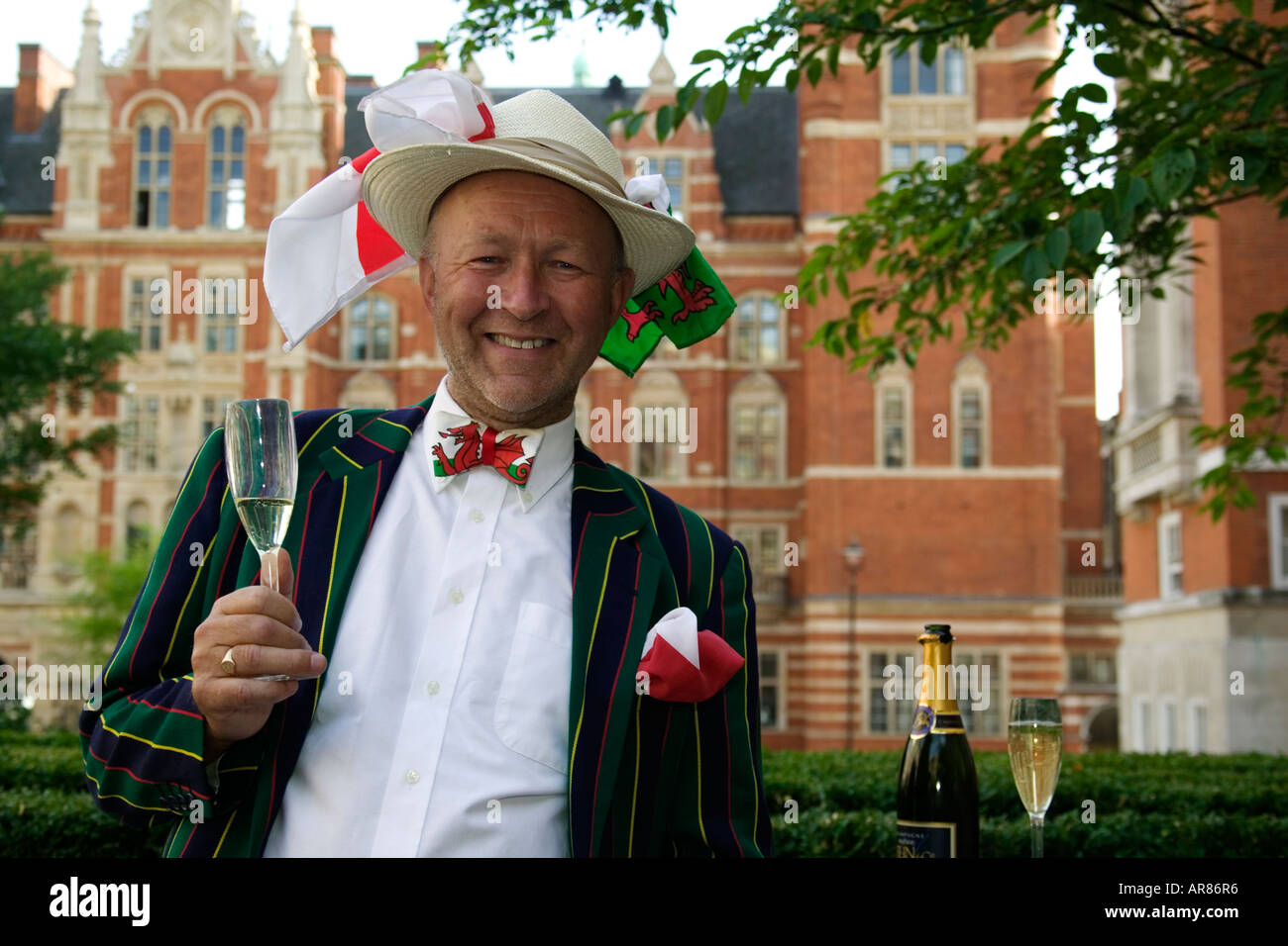 Gentleman with flags on his hat and a glass of champagne at the Last Night of the Proms - Stock Image
