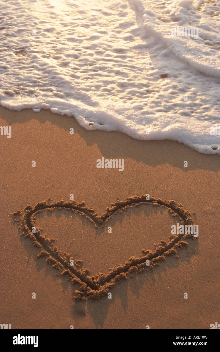 Heart drawn in sand Stock Photo