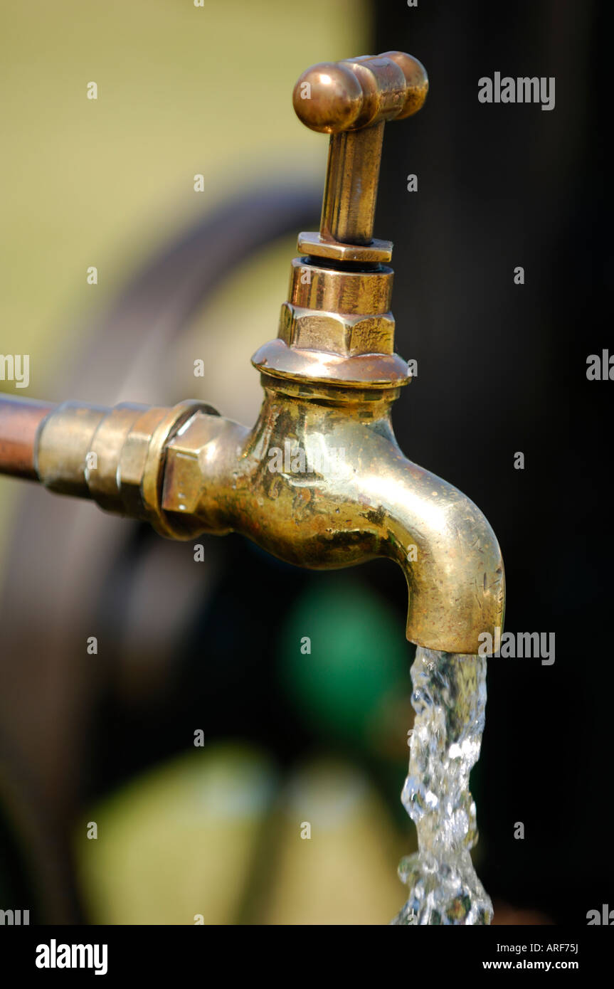 Tap Flowing Running Fresh Water Coming Out Of A Tap An Outside Garden Water  Shortages Droughts Utilities Bills Energy Board Out