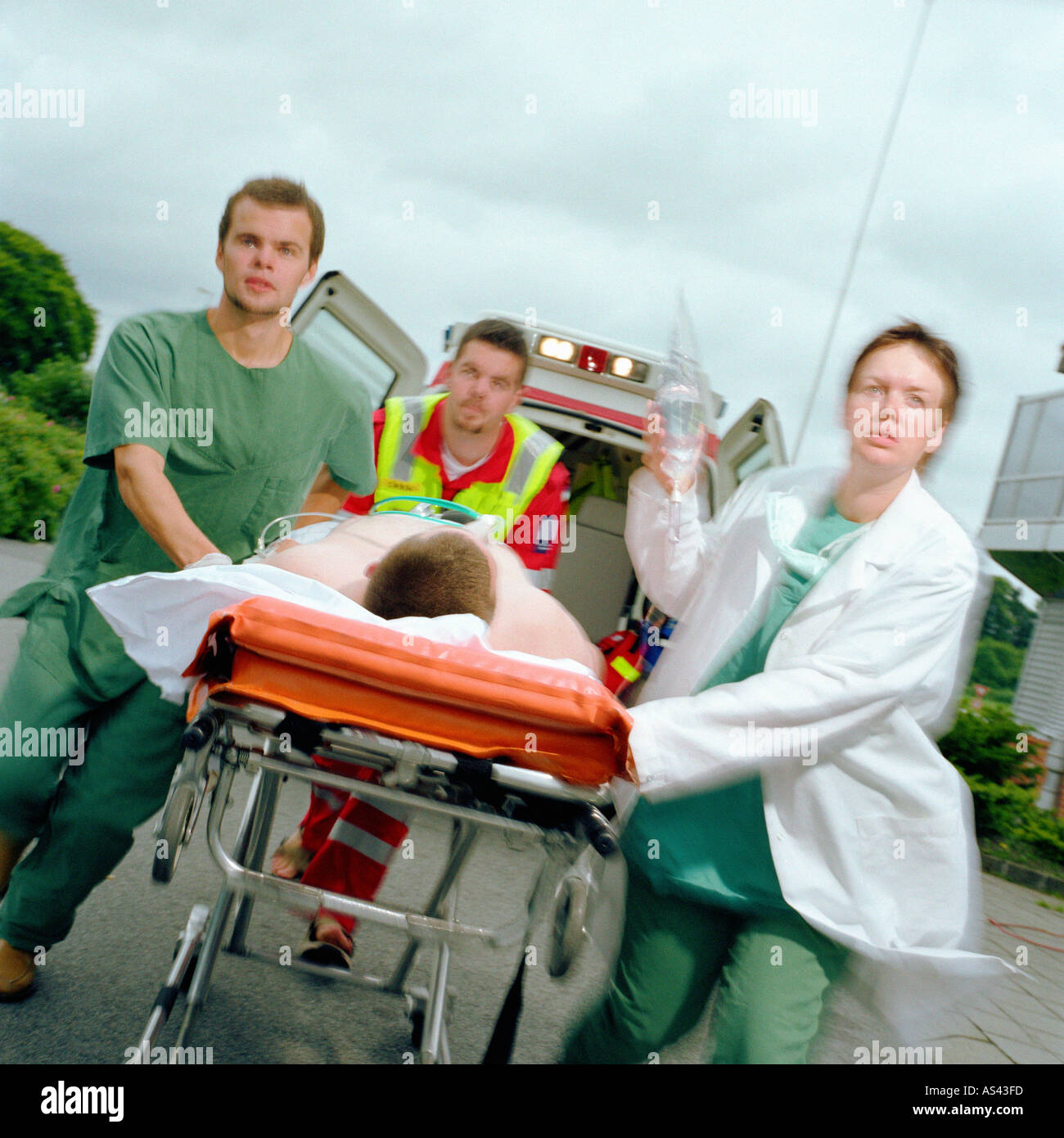 Ambulance staff with patient - Stock Image