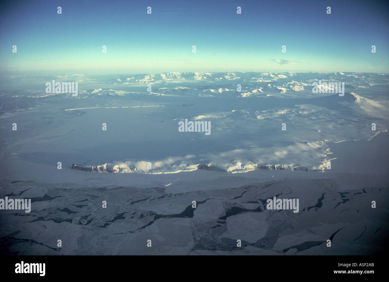 Aerial view Antarctic coastline and Transantarctic Mountains Early spring Terra Nova Bay Cape Washington Mount Melbourne - Stock Image