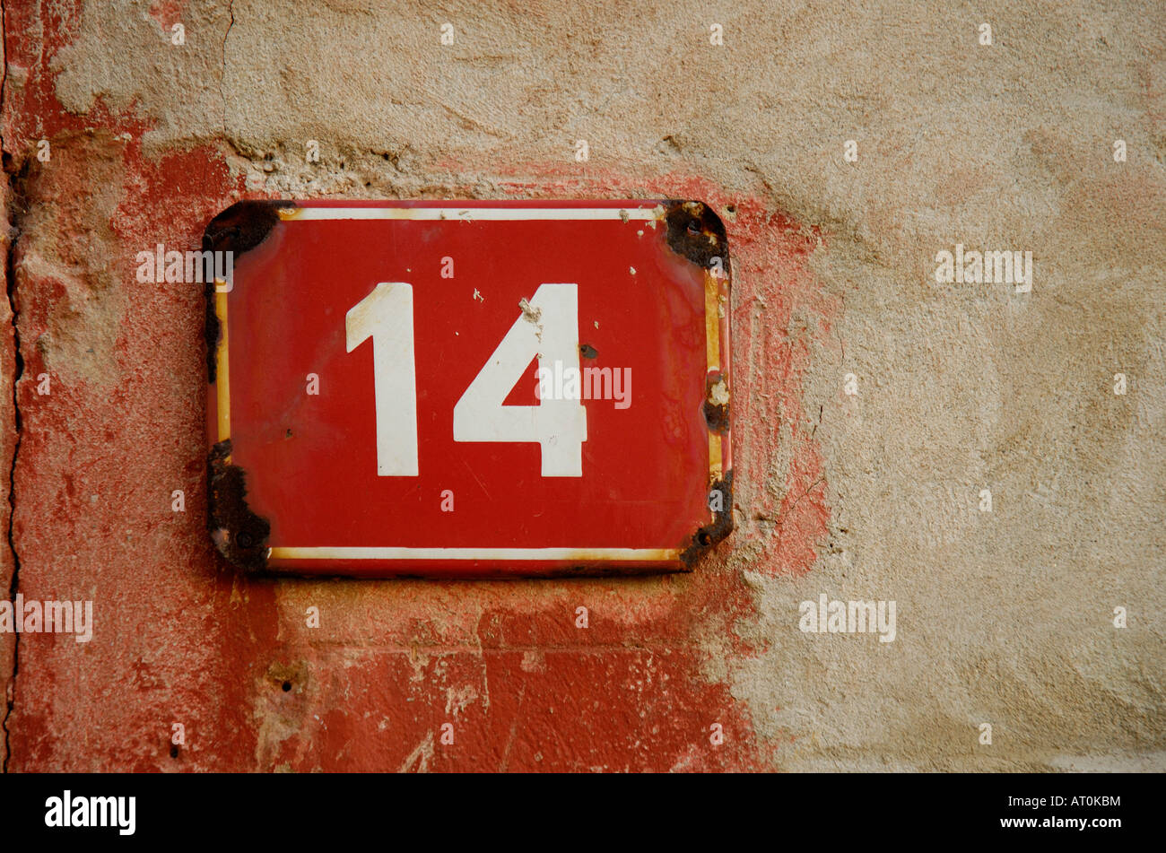 DOOR NUMBER FOURTEEN 14 ON A OLD WALL BACKGROUND - Stock Image
