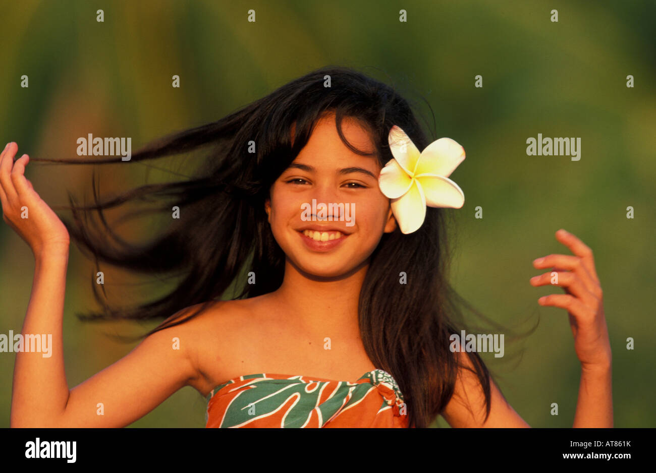 Young local hawaiian girl smiling with flower in her hair stock young local hawaiian girl smiling with flower in her hair izmirmasajfo Gallery