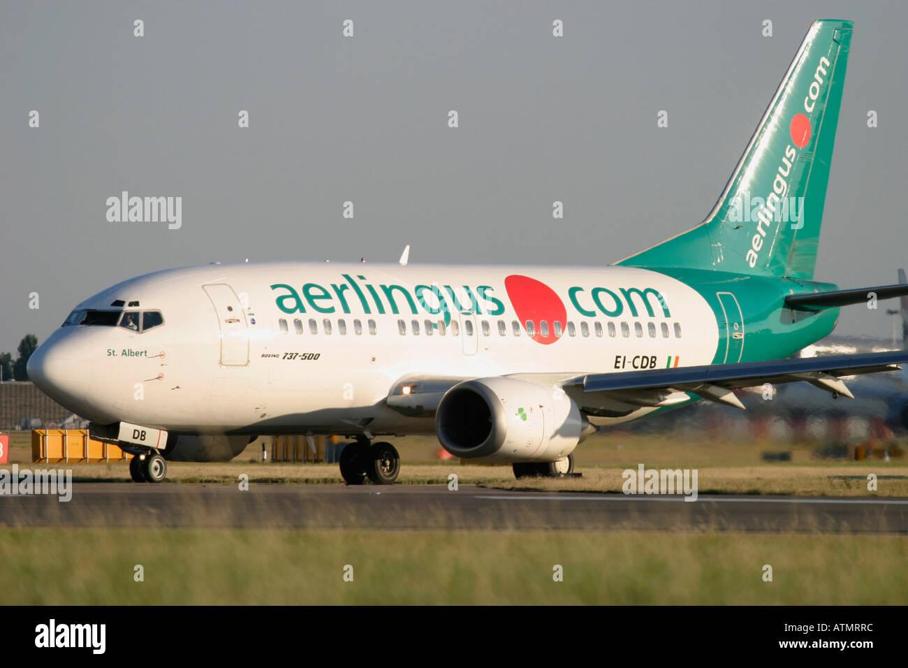 Aer Lingus Boeing 737-548  at London Heathrow Airport - Stock Image