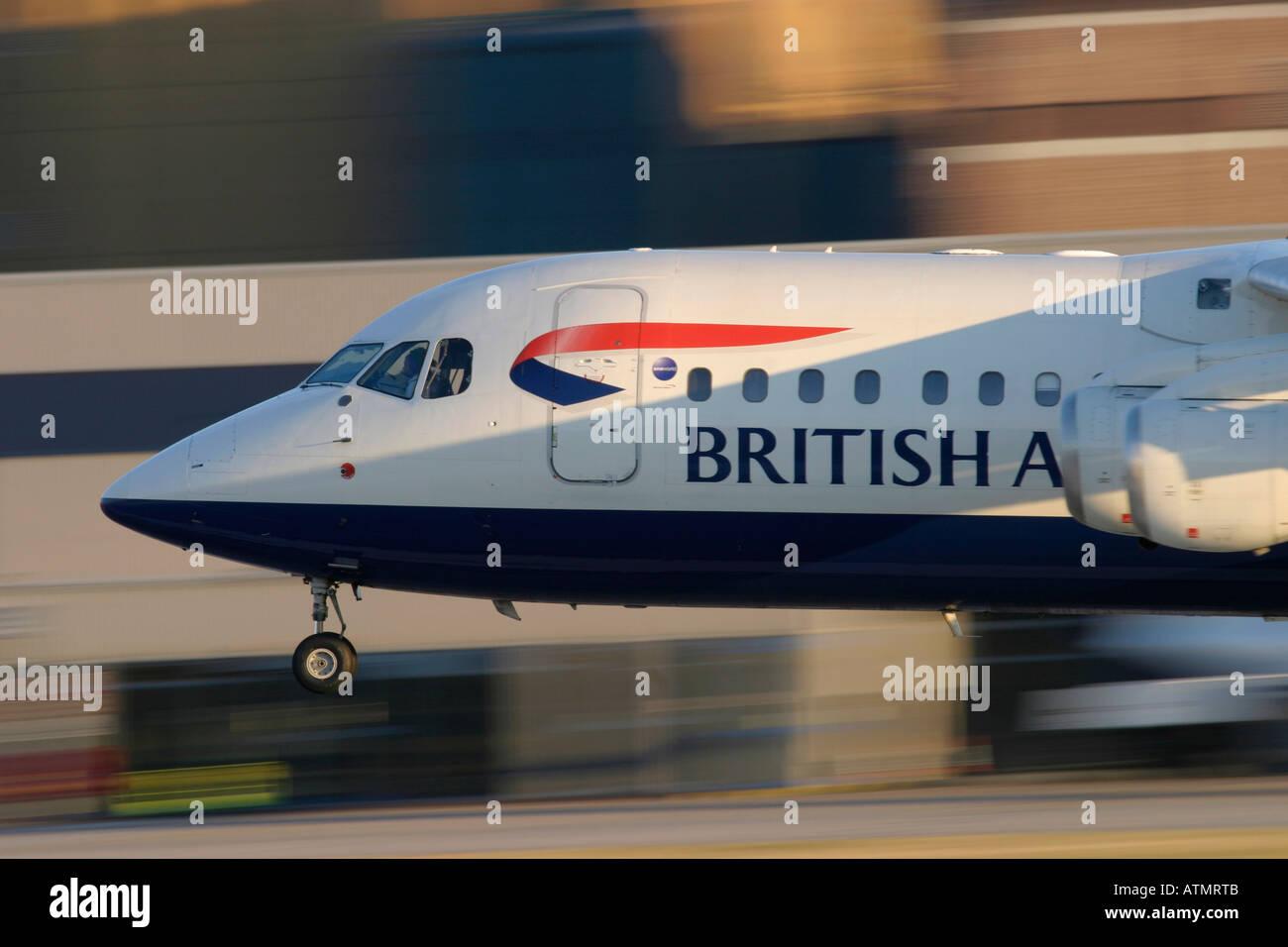 British Airways British Aerospace BAe-146-200A landing at London City Airport UK - Stock Image