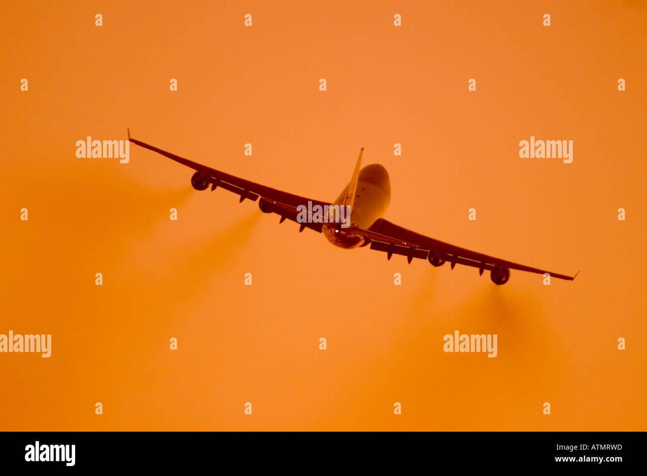 Commercial jet flying with smoke comeing from the engines - Stock Image