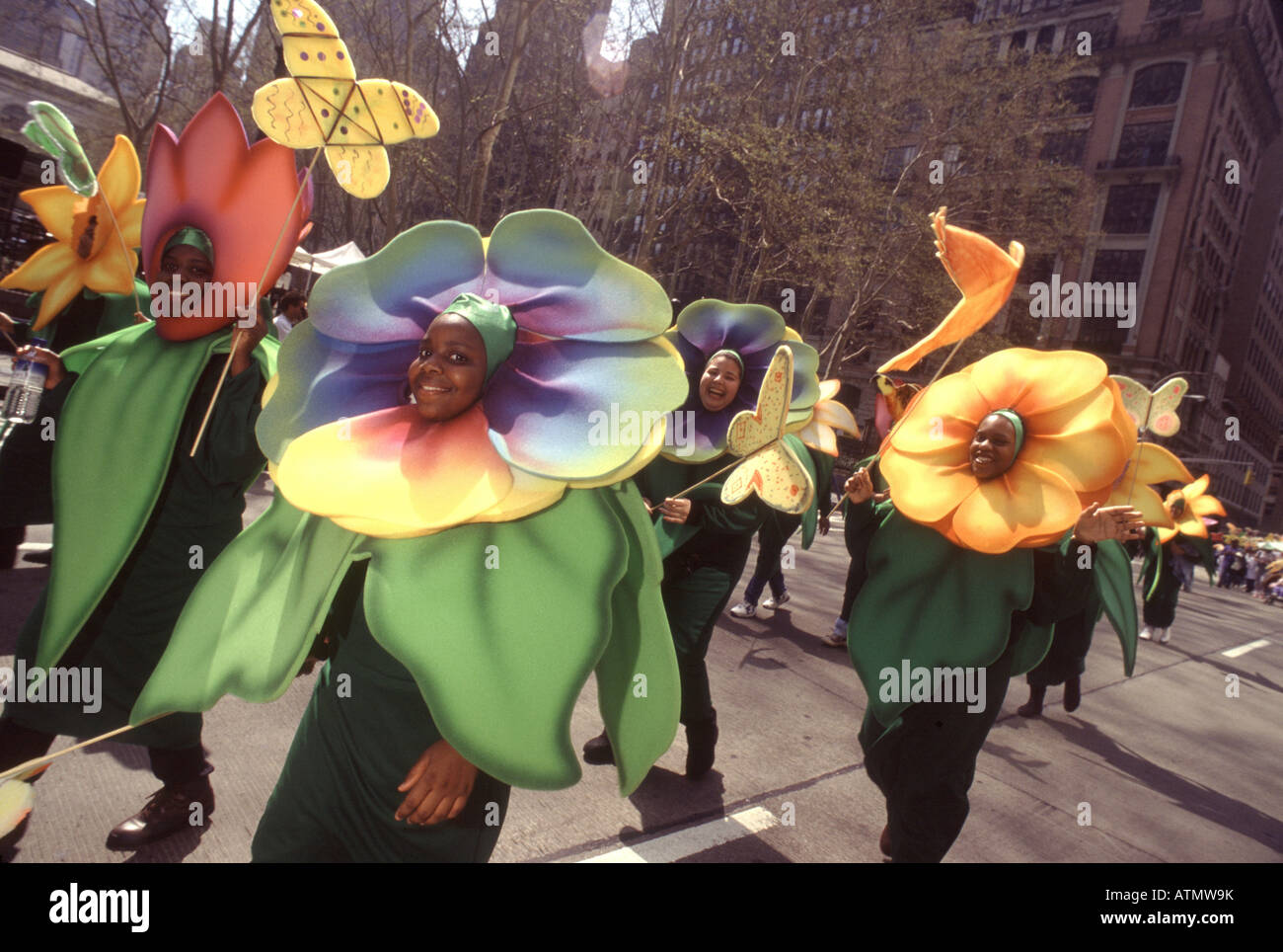 Earth Day New York City.Parade of the Planets. Environmentalists dressed as colorful flowers march up the Avenue - Stock Image