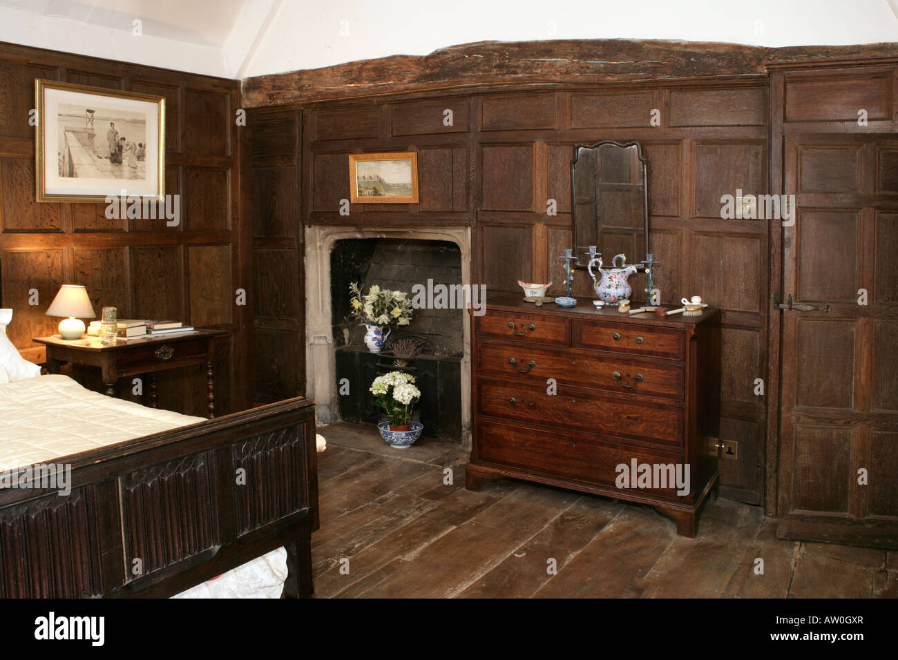 A House Interior, Period Dark Wood Panelled Bedroom.