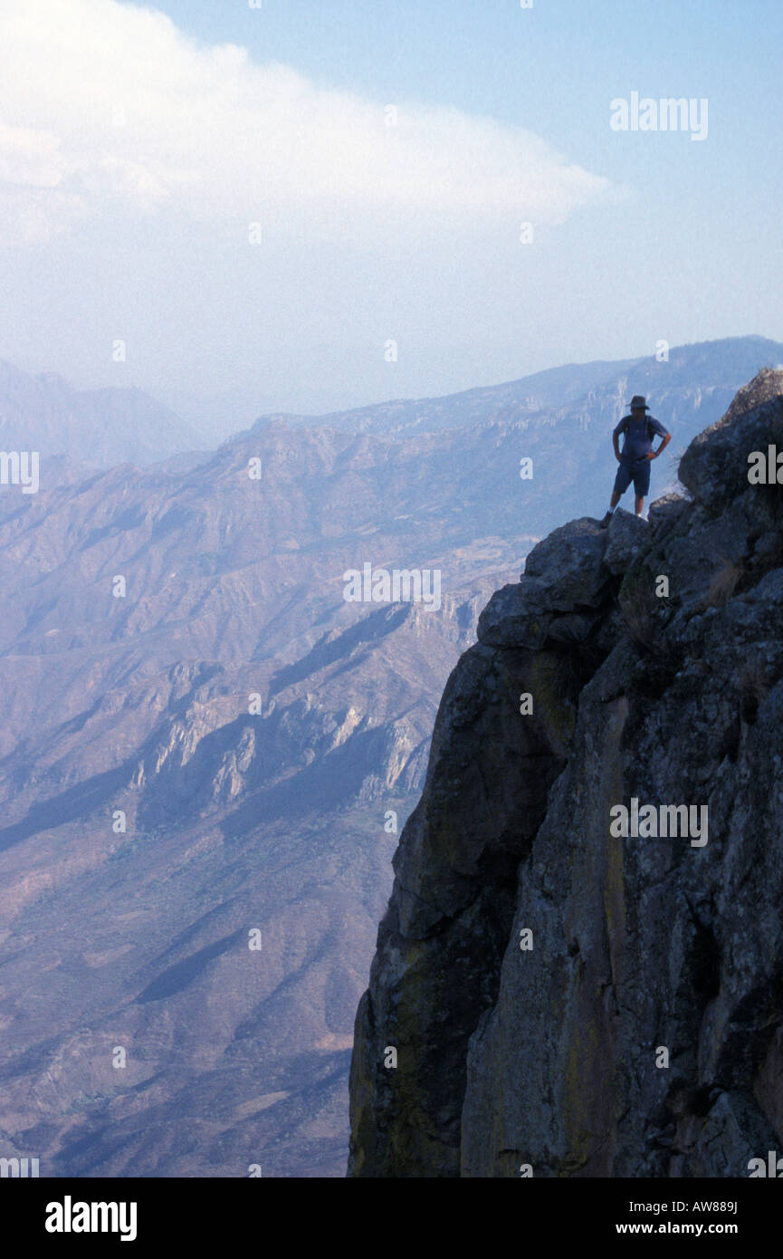 hiker-standing-on-the-rim-of-the-copper-