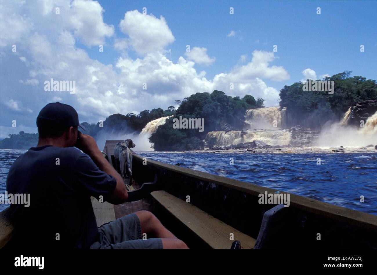 tourist-photographing-saltos-hacha-water