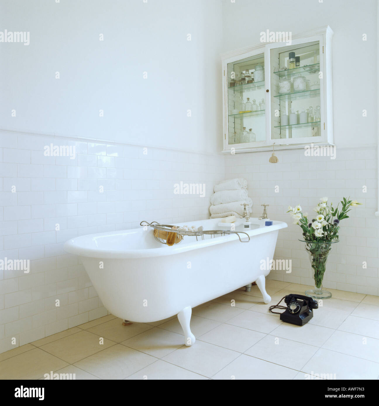 Traditional white roll-top bath in modern white bathroom with alcove ...