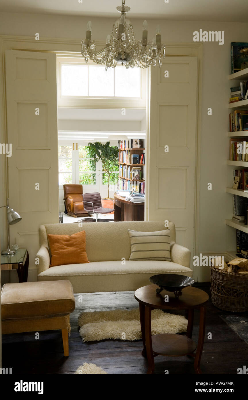 sitting room with view through to home office in the London townhouse - Stock Image