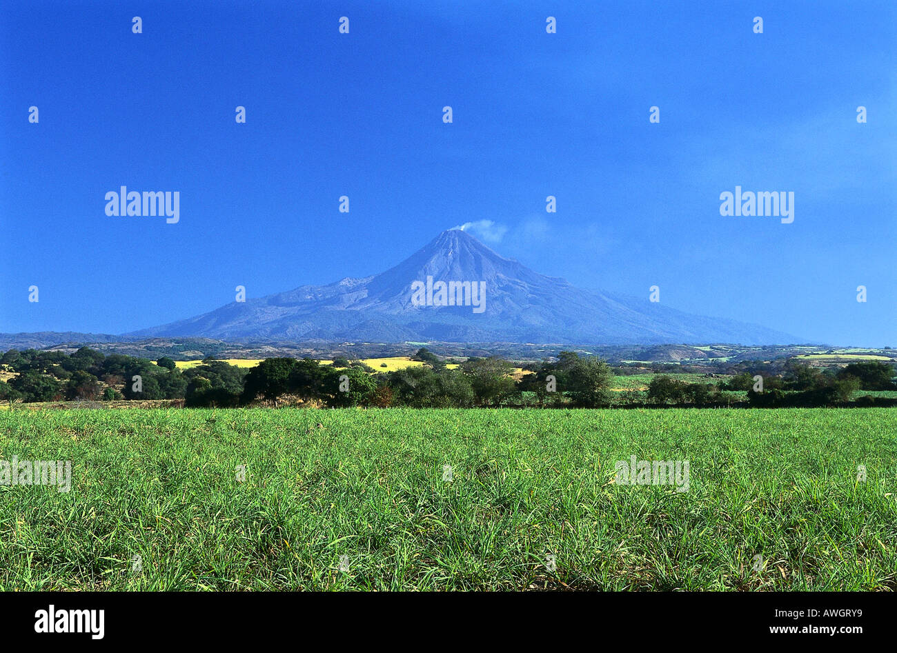Volcan de Fuego, seen from the road heading out of Colima toward Guadalajara, Mexico. - Stock Image