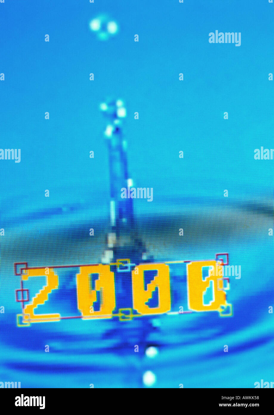 2000, text and drop falling into water - Stock Image