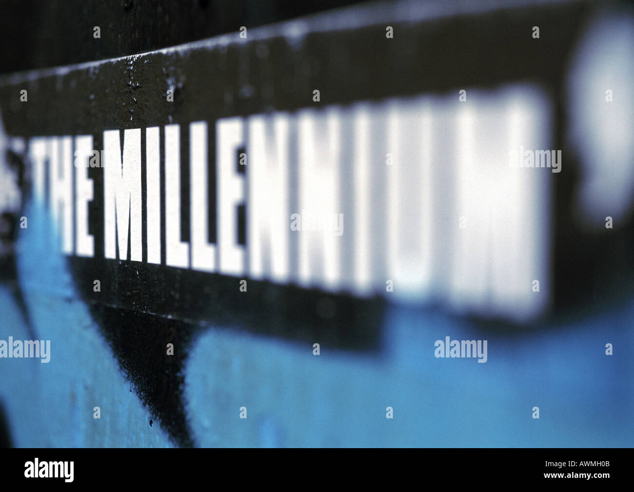 The millenium text printed in capital letters, blurred - Stock Image