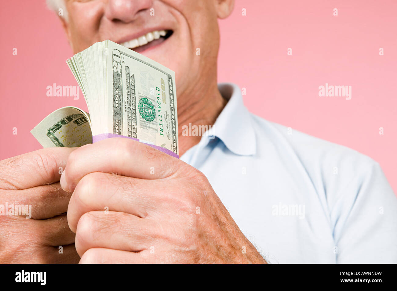 Man with bundle of banknotes - Stock Image