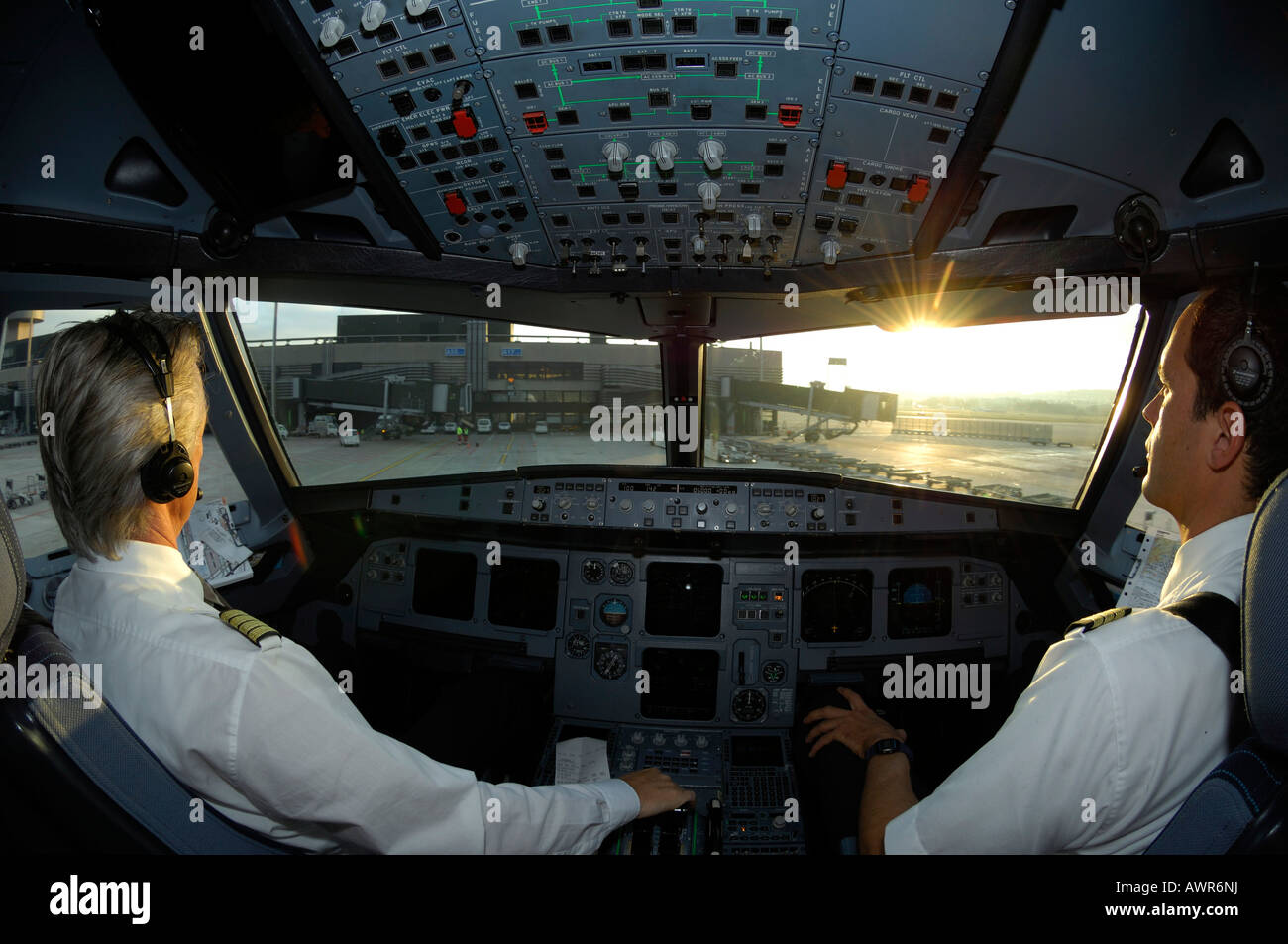 Pilots in the cockpit of an Airbus 321, taxiing to gate after landing - Stock Image