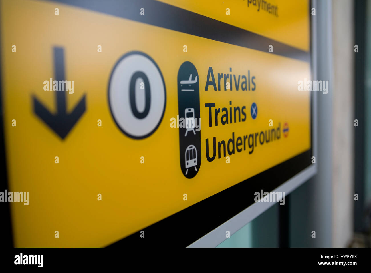 An arrivals, trains and underground sign at London Heathrow Airport, terminal 5 - Stock Image