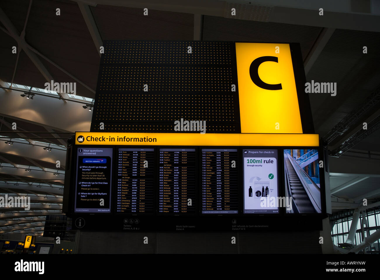 An electronic destination and arrival board at London Heathrow Airport Terminal 5 - Stock Image
