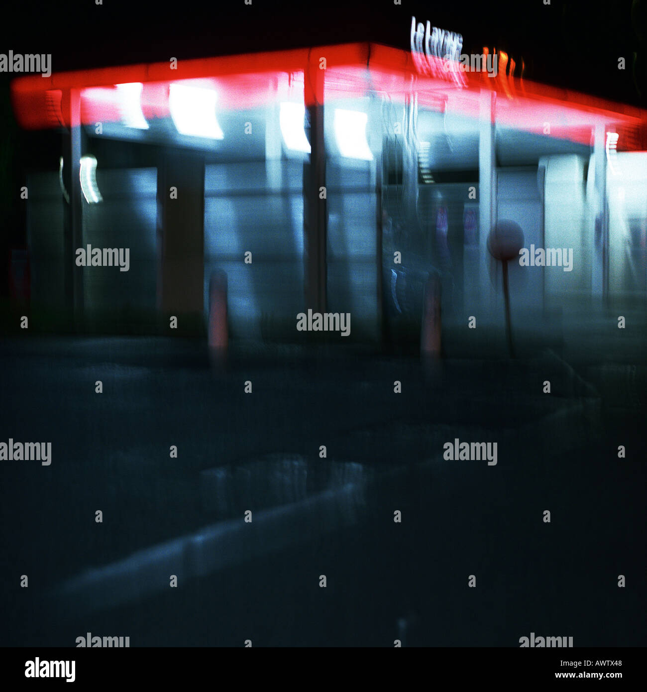 Deserted service station at night, long exposure - Stock Image