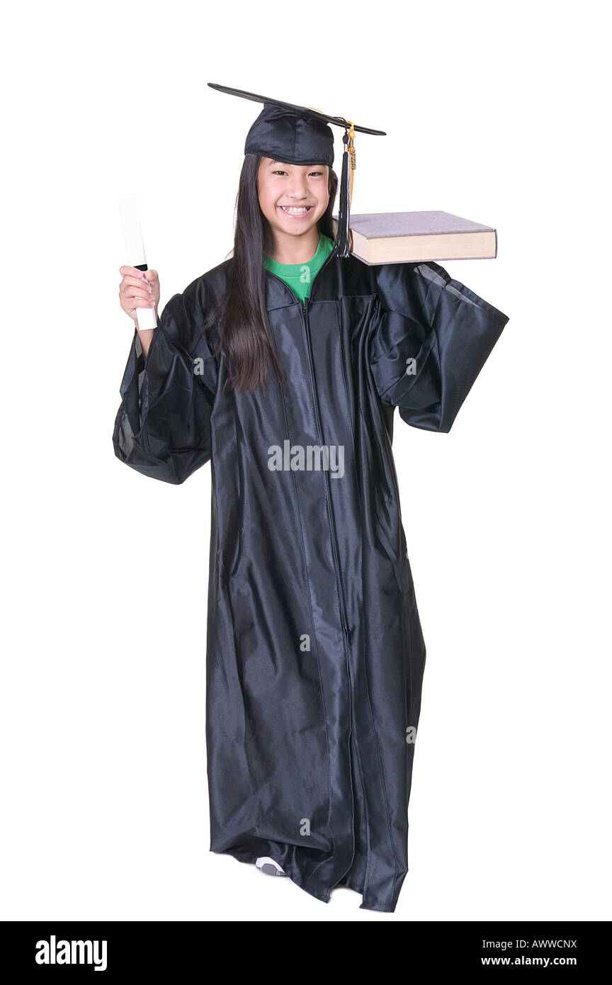Girl in Graduation Gown Balancing Book on Her Shoulder Stock Photo ...