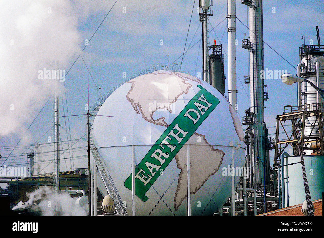 """Digitally altered view of a tank painted as a globe with the words """"Earth Day""""  at a Unocal oil refinery in Los - Stock Image"""