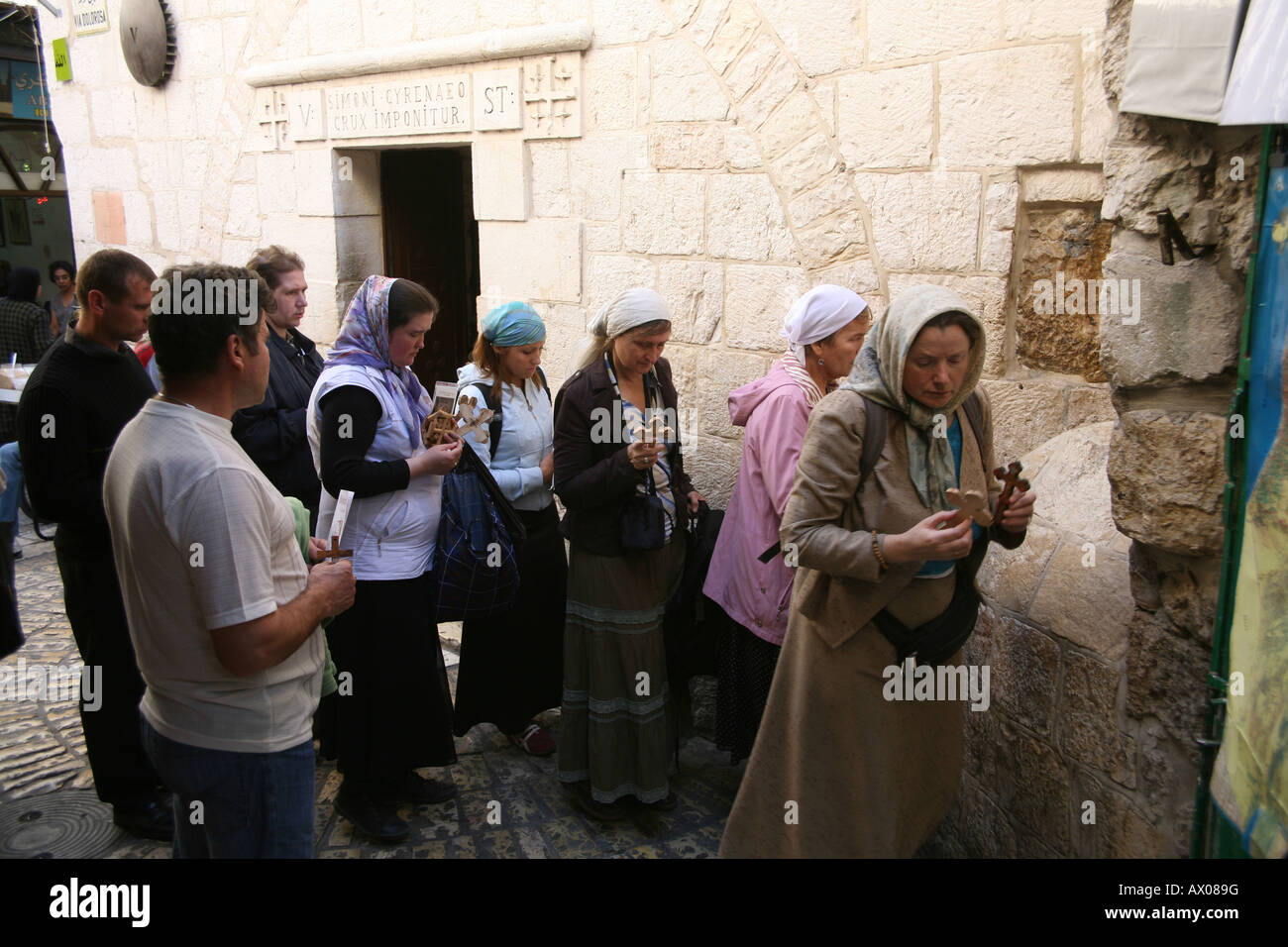 People walk along the Via Dolorosa in the old city section of Jerusalem - Stock Image