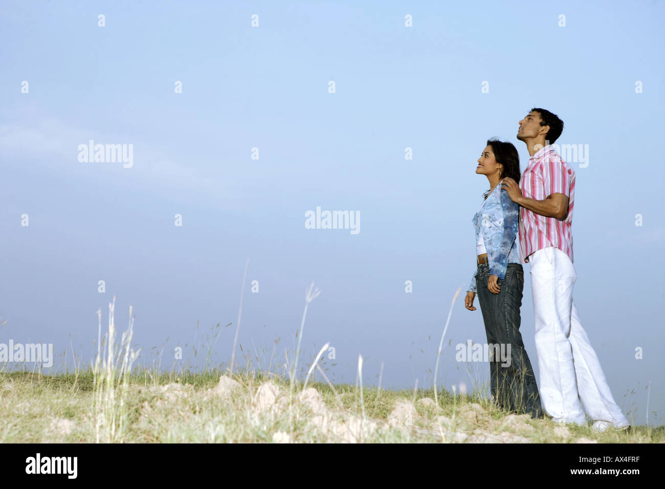 Side profile of a young couple dreaming in a park Stock Photo