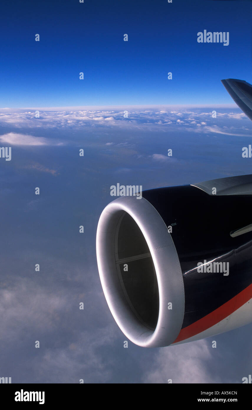 Aircraft engine viewed from the window of an airplane - Stock Image