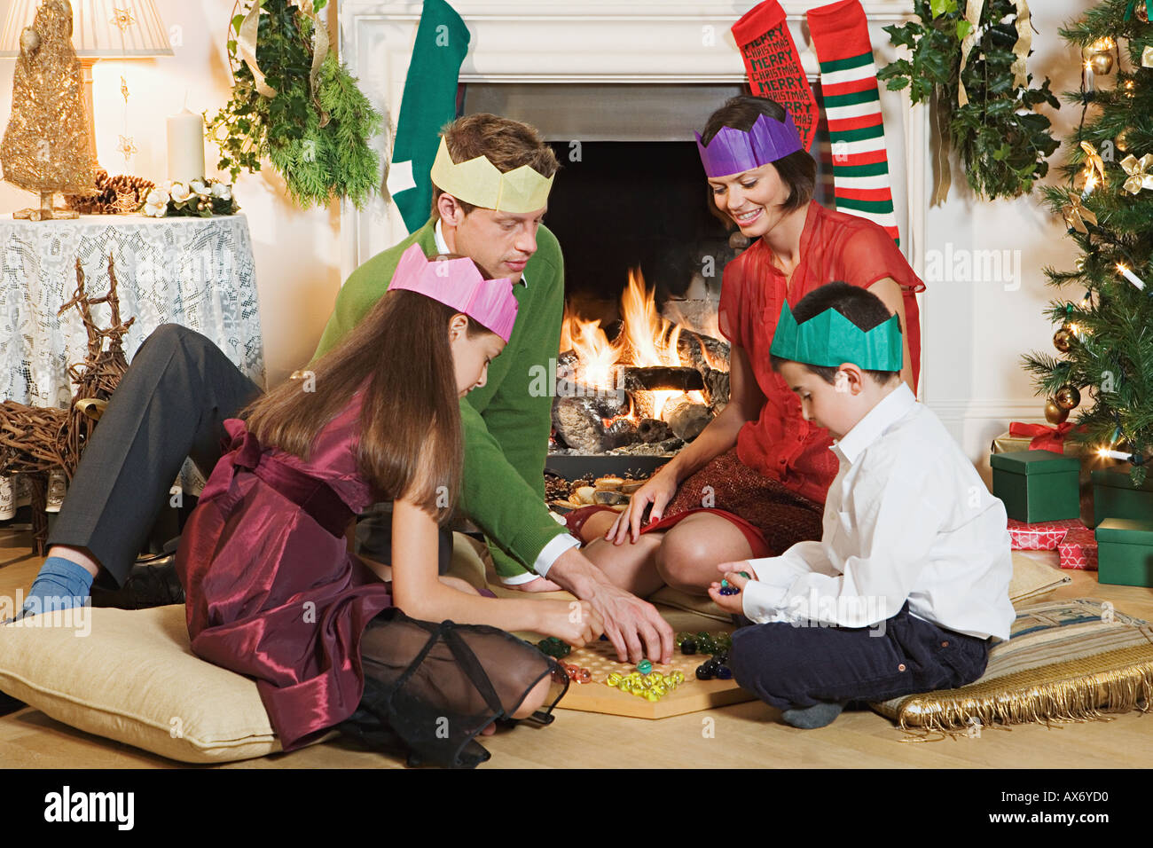 Family playing a board game at christmas Stock Photo