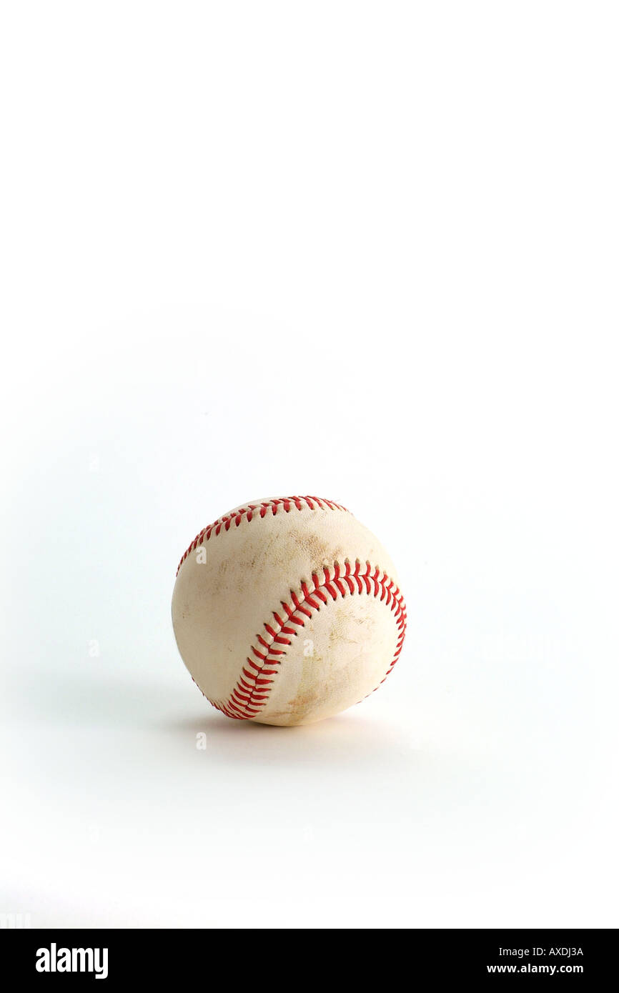 Leather baseball with red stitching slightly dirty as is used in American Baseball Games room for type vertical - Stock Image