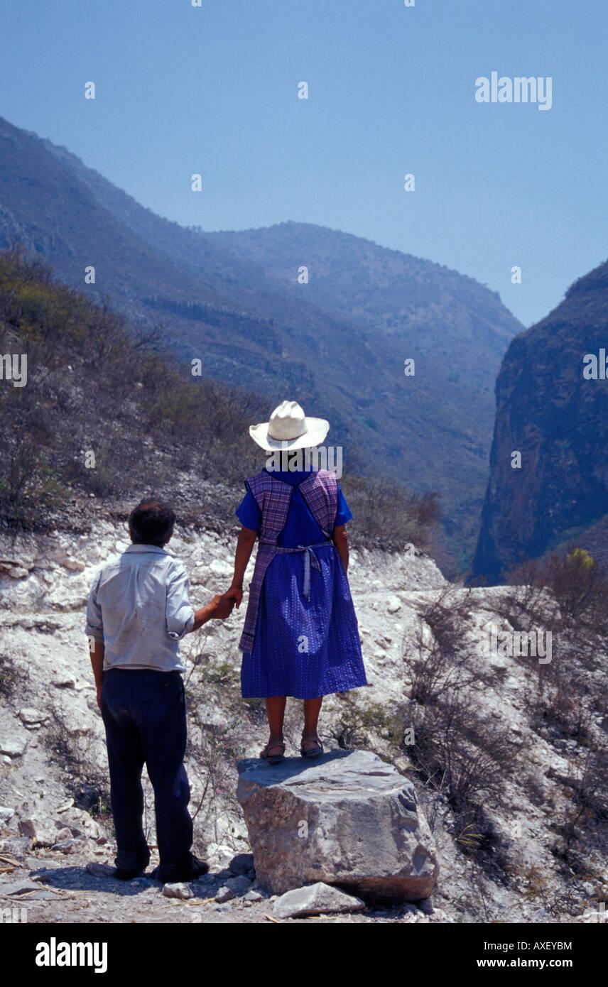 elderly-indigenous-couple-holding-hands-