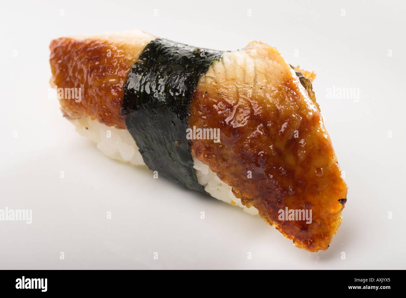 unagi eel fresh seafood brown white fish seaweed rice rapped appetizer meal Asian consumption eat food - Stock Image