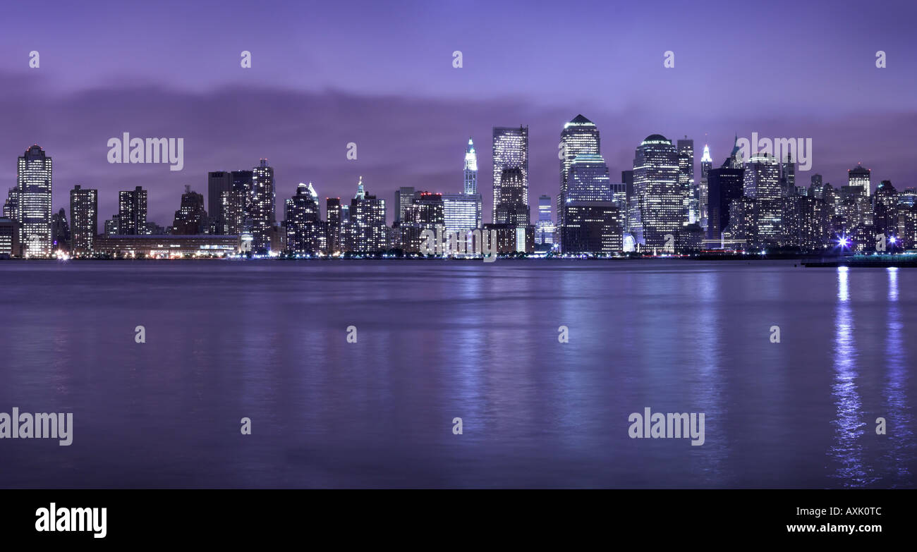 city urban day night light work career job building sky water clouds purple blue black reflection travel vacation - Stock Image