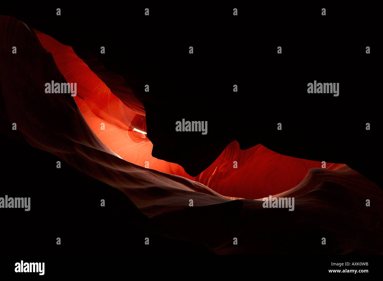 desert ground rock dirt low narrow round tunnel walls hole light shadow adventure sand distance nature ceiling slant - Stock Image