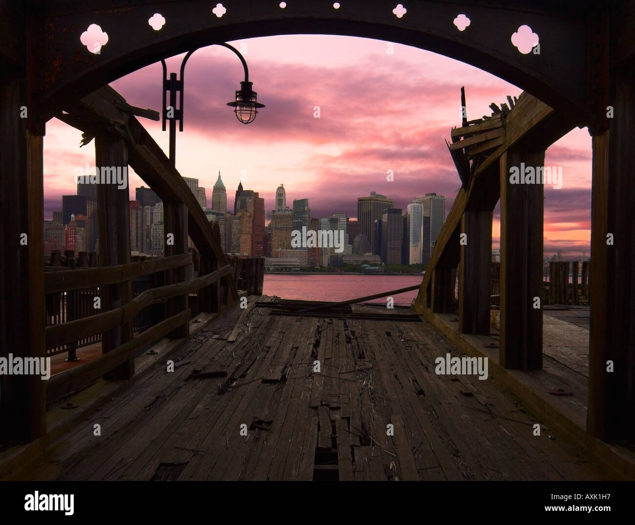 bridge boards rail at end water lamp ceiling arch urban city at evening sunrise morning sunset pink sky clouds water - Stock Image
