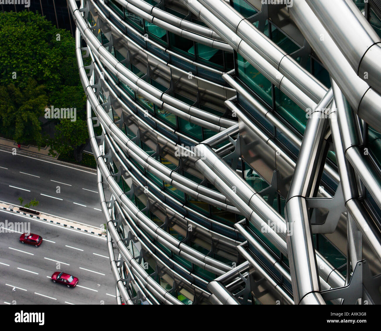 business working new city skyscraper building windowns office lines angles round ground highway road cars red drive - Stock Image