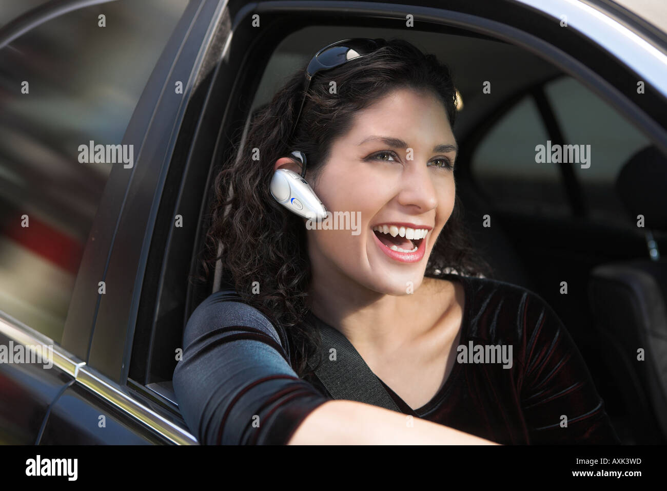 girl lady woman person on phone smile safety arm travel transport car movement travel drive - Stock Image