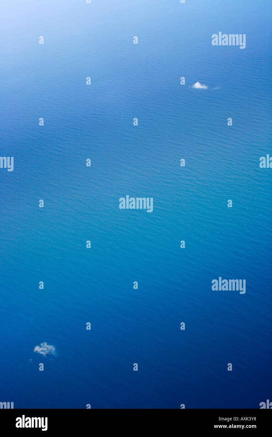 tropical blue water life nature drink swim splash white ripple calm still ocean lake river day - Stock Image