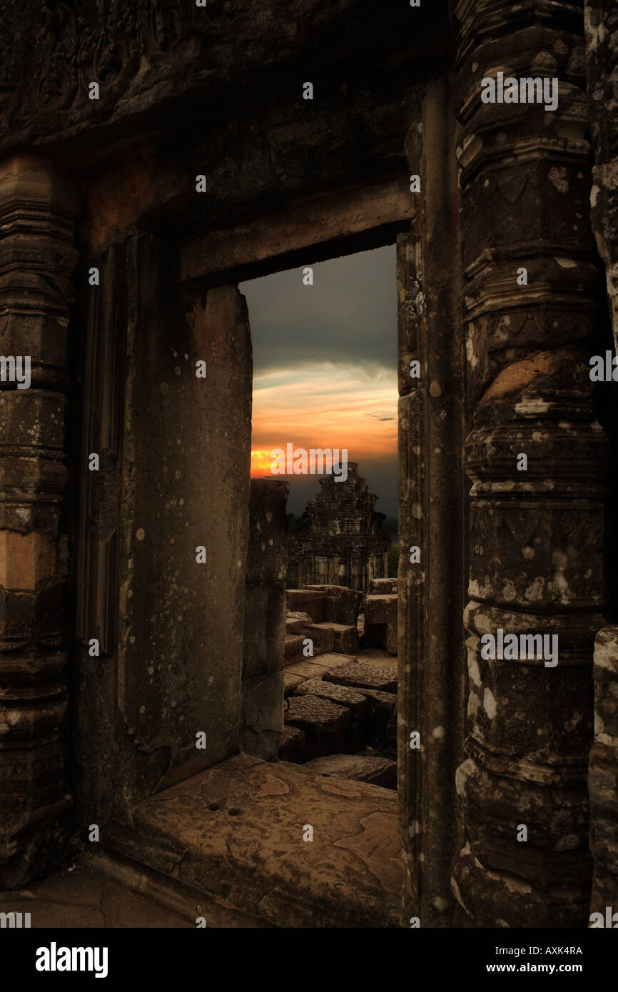 Angkor Wat Cambodia doorway open clouds sun sunset evening morning sky stone floor ancient building architecture - Stock Image