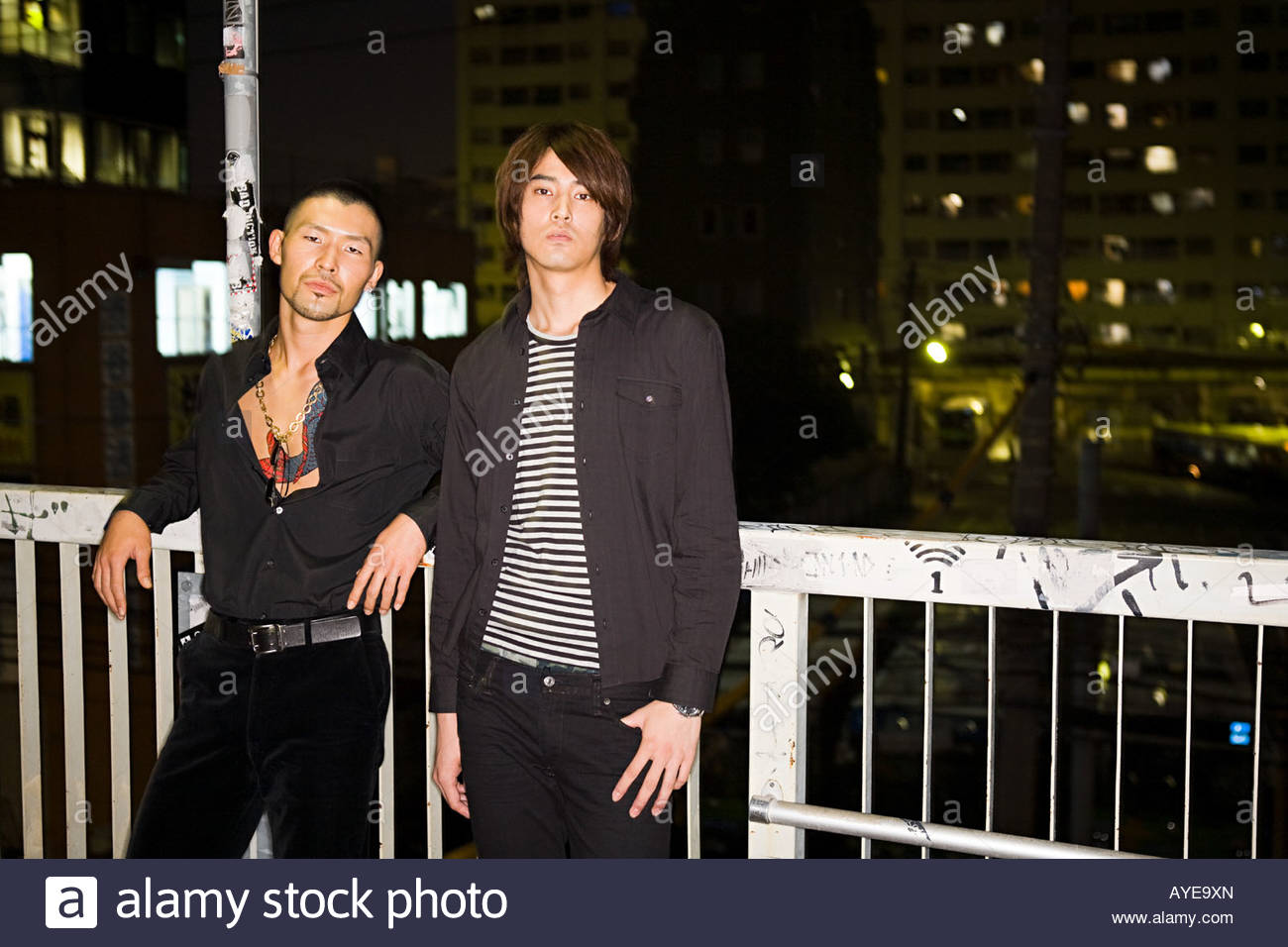 Two japanese men against urban backdrop - Stock Image