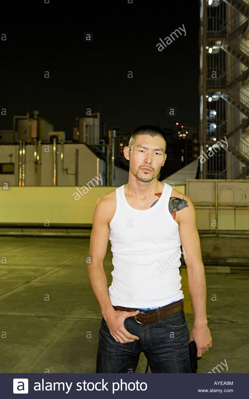 Japanese man with urban backdrop - Stock Image