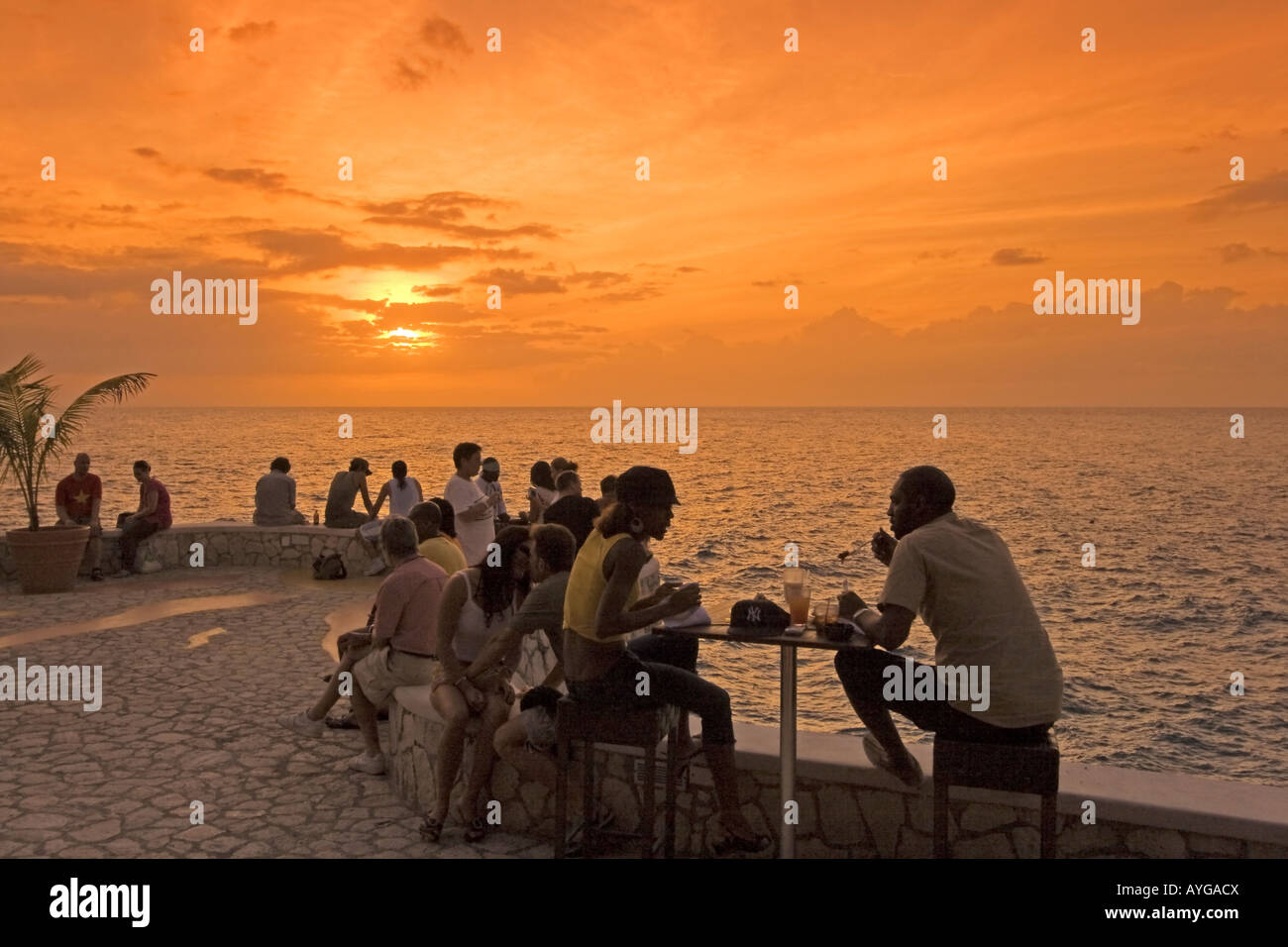 Jamaica Negril Ricks Cafe open air bar viewpoint at sunset - Stock Image