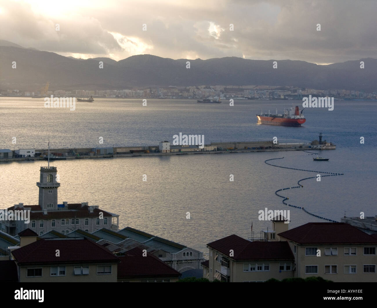 Dusk over the Bay of Gibraltar, Custom House, boom, shipyard shipyards sunset sunsets dusk evening nightfall  Gibraltar - Stock Image