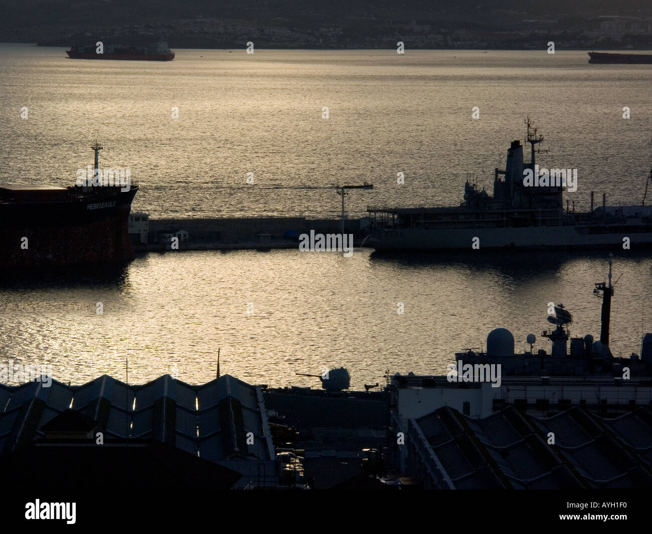 Dusk over the Bay of Gibraltar, Europe, Tankers, Warships, - Stock Image