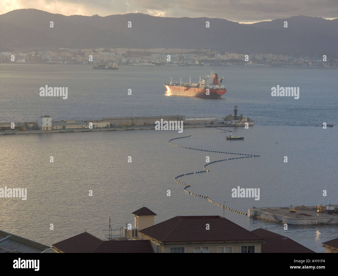 Dusk over the Bay of Gibraltar, boom, shipyard shipyards sunset sunsets dusk evening nightfall  Gibraltar Harbour - Stock Image
