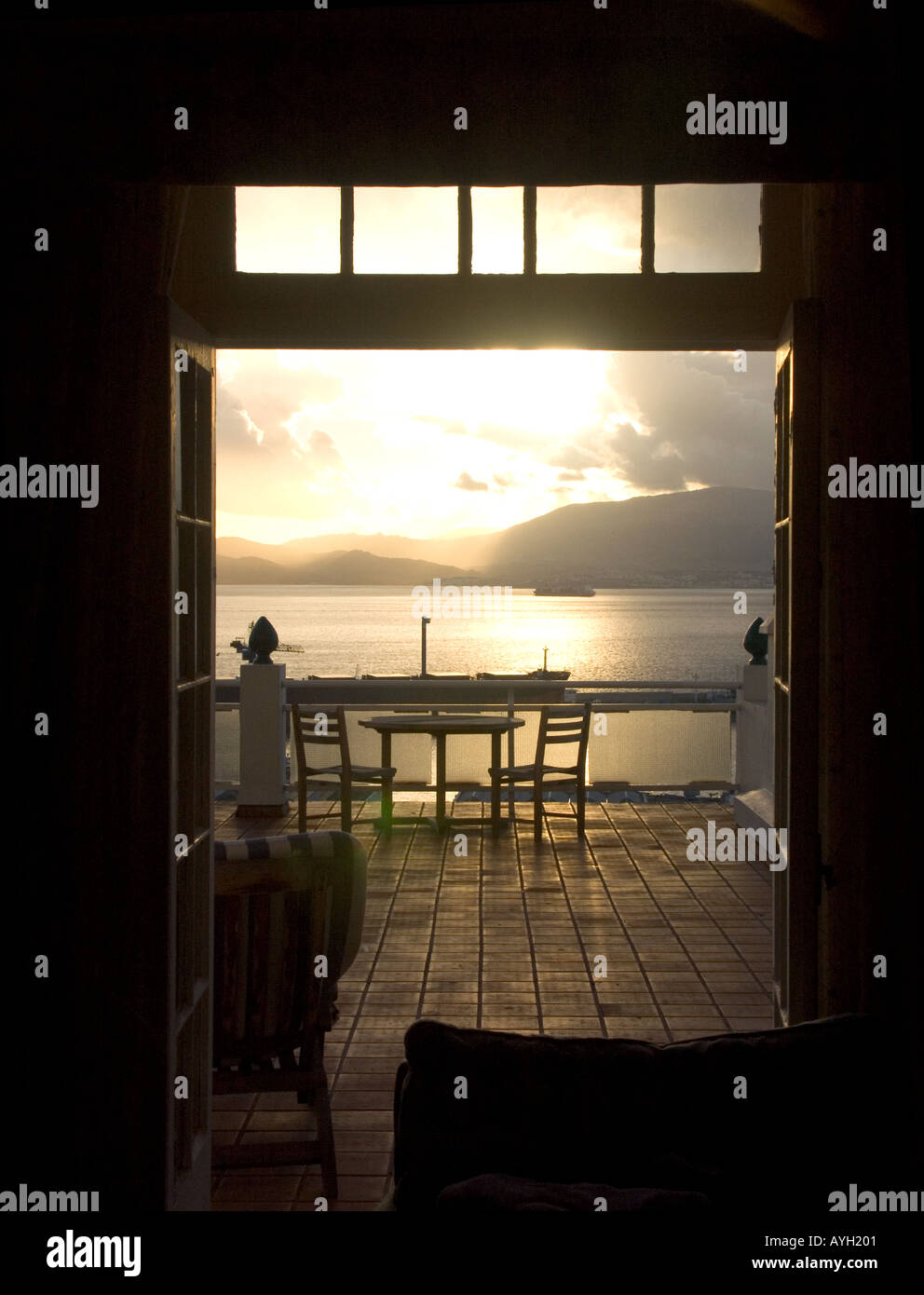Dusk over the Bay of Gibraltar through hotel patio doors - Stock Image