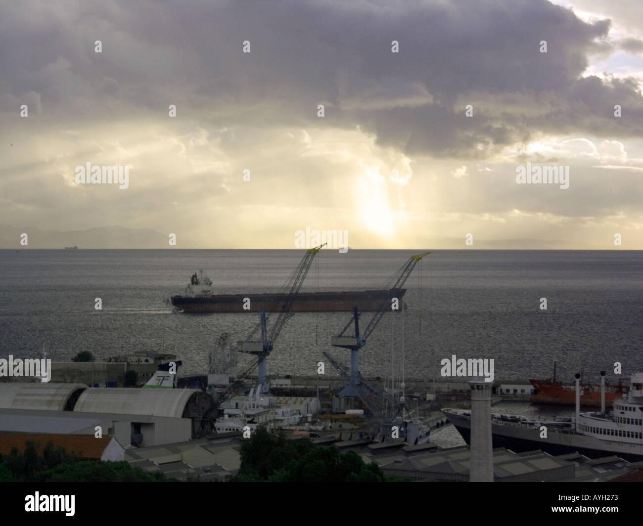 Sunset, dusk over the Bay of Gibraltar, shipyard shipyards sunset sunsets dusk evening nightfall  Gibraltar Harbour - Stock Image